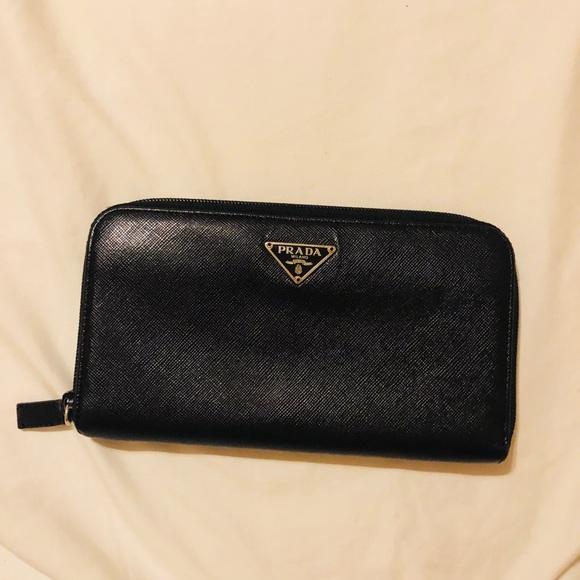 55b4472dd0aead ... sale authentic black prada saffiano zip around wallet. a7c5c 5e5ef